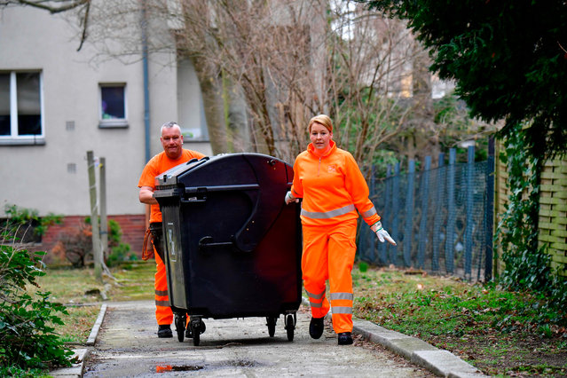 Franziska Giffey (SPD), Federal Minister of Family Affairs, accompanies a waste disposal tour and pushes a garbage can over the sidewalk together with an employee of the Berliner Stadtreinigungsbetriebe (BSR) in Berlin, Germany on March 7, 2019. Giffey takes part in the first network meeting of female garbage workers from all over Germany on the occasion of this year's World Women's Day. (Photo by Monika Skolimowska/dpa-Zentralbild/dpa)
