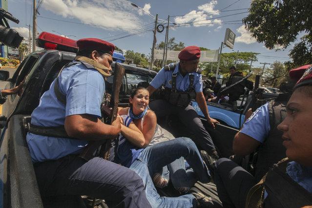 Police detain protesters in Managua, Nicaragua, Saturday, March 16, 2019. (Photo by Alfredo Zuniga/AP Photo)