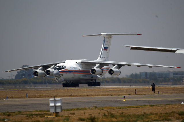 """A """"Ilyushin IL-76"""", a firefighting plane from Russia, is seen at Santiago's airport after arriving to reload water during a mission to extinguish wildfires in Chile's central-south regions, Chile February 2, 2017. (Photo by Ivan Alvarado/Reuters)"""