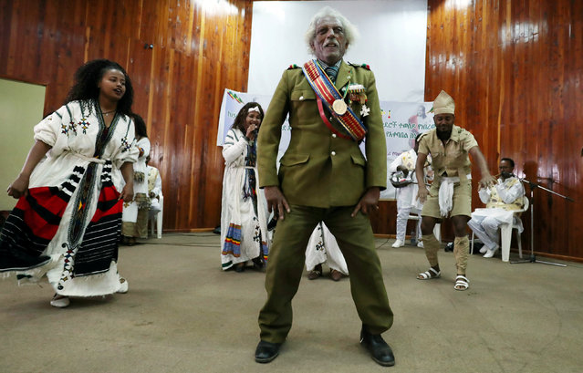 An Ethiopian army veteran dances during the welcoming ceremony of the two locks of hair of the Emperor Tewodros II after it is repatriated from Britain's National Army Museum in Addis Ababa, Ethiopia March 23, 2019. (Photo by Tiksa Negeri/Reuters)