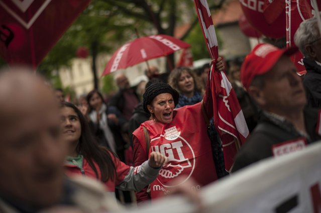 Workers shout slogans as they march on the street during May Day, in Pamplona northern Spain, Friday, May 1, 2015. Tens of thousands of workers marked May Day in European cities with a mix of anger and gloom over austerity measures imposed by leaders trying to contain the eurozone's intractable debt crisis. (Photo by Alvaro Barrientos/AP Photo)