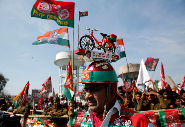 Indian supporters of Congress party and Samajwadi Party (SP) wave party flags and banners at an election rally, ahead of Assembly elections, in Meerut, Uttar Pradesh, 07 February 2017. The Samajwadi Party (SP) and the Congress alliance is contesting the Uttar Pradesh Assembly polls together. The assembly poll process in Uttar Pradesh begins on 11 February. (Photo by Rajat Gupta/EPA)