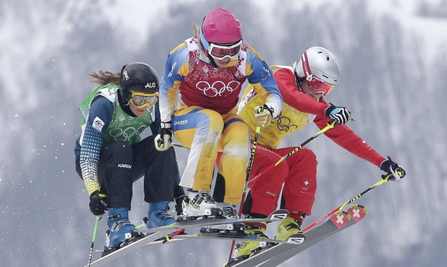 Australia's Katya Crema, from left, Sweden's Sandra Naeslund and Switzerland's Fanny Smith compete during their ski cross race at the 2014 Winter Olympics, Friday, February 21, 2014, in Krasnaya Polyana, Russia. (Photo by Matthias Schrader/AP Photo)