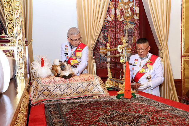 Royal officials place a chicken and a cat next to the bed of Thailand's King Maha Vajiralongkorn during the ceremony of Assumption of the Royal Residence inside the Grand Palace in Bangkok, Thailand, May 4, 2019. Picture taken May 4, 2019. (Photo by The Committee on Public Relations of the Coronation of King Rama X via Reuters)