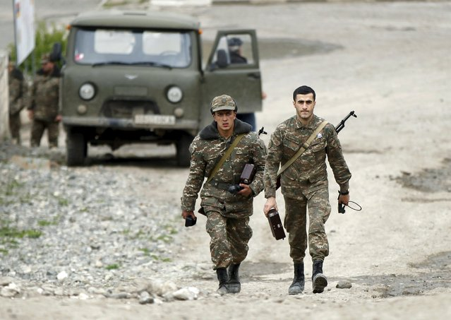 Servicemen of the self-defense army of Nagorno-Karabakh walk at a military base in the village of Mataghis April 6, 2016. (Photo by Reuters/Staff)