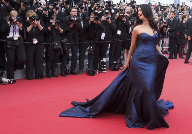 """Actress Mallika Sherawat poses on the red carpet as she arrives for the screening of the film """"Macbeth"""" in competition at the 68th Cannes Film Festival in Cannes, southern France, May 23, 2015. (Photo by Yves Herman/Reuters)"""