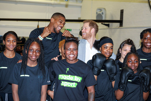 Britain's Prince Harry and boxer Anthony Joshua react during the launch of Made by Sport, a new campaign bringing together a coalition of charities supporting disadvantaged young people through sport, at Black Prince Trust in London, Britain, June 12, 2019. (Photo by Alex Lentati/Pool via Reuters)
