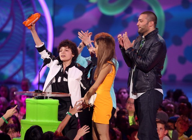 "From left, Cameron Ocasio, Ariana Grande, and Zoran Korach accept the award for favorite TV show for ""Sam & Cat"" at the 27th annual Kids' Choice Awards at the Galen Center on Saturday, March 29, 2014, in Los Angeles. (Photo by Matt Sayles/Invision/AP Photo)"