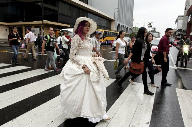 "Adriana Barahona, known as "" Madame Barocle,"" crosses a street while dressed in clothing of the Victorian era in San Jose, Costa Rica June 4, 2015. Barahona says she has been passionate about clothing from the era of Britain's Queen Victoria (1837-1901), and has been making and wearing them since the age of 15. REUTERS/Juan Carlos Ulate"