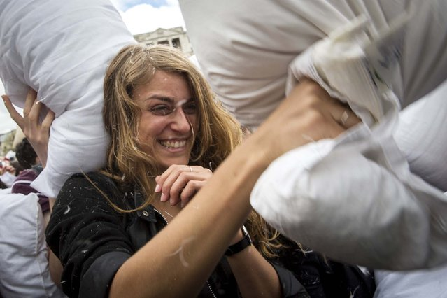 Revelers take part in the pillow fight in London. (Photo by Rob Stothard/Getty Images)