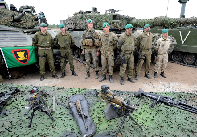 Norwegian soldiers stand next to their gear after the NATO Noble Jump exercise on a training range near Swietoszow Zagan, Poland, Thursday, June 18, 2015. (AP Photo/Alik Keplicz)