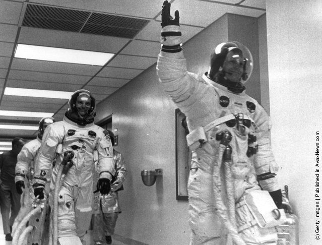 Neil Armstrong leads Edwin 'Buzz' Aldrin and Michael Collins out of the space centre on the Apollo 11 space mission to the moon, 1969