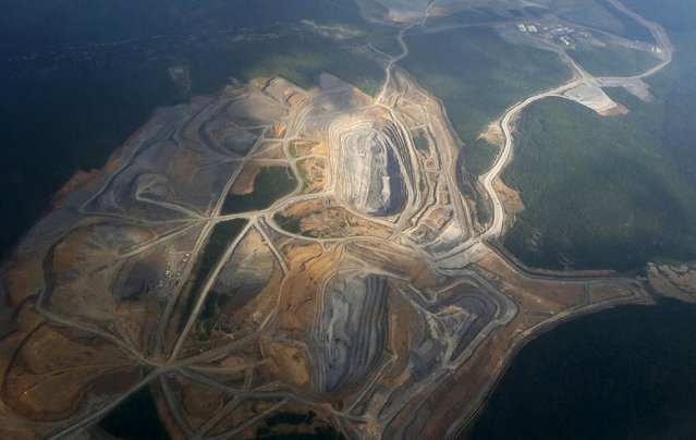 An aerial view from a plane shows the Blagodatnoye gold operation, owned by Polyus Gold International company, in Krasnoyarsk region, Eastern Siberia, Russia, July 1, 2015. (Photo by Ilya Naymushin/Reuters)