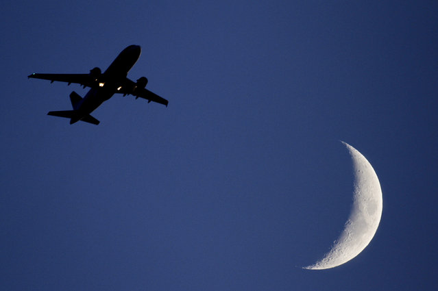 In this file photo dated Wednesday June 16, 2010, a plane takes off into the night sky from London's Heathrow Airport. Three airliners narrowly missed colliding with drones near London's Heathrow Airport in the space of three weeks last year, according to a report released Friday March 31, 2017, by the U.K. Airprox Board organisation which catalogs air safety incidents, underscoring increasing concerns about the drone devices proximity to aircraft. (Photo by Odd Andersen/AP Photo)