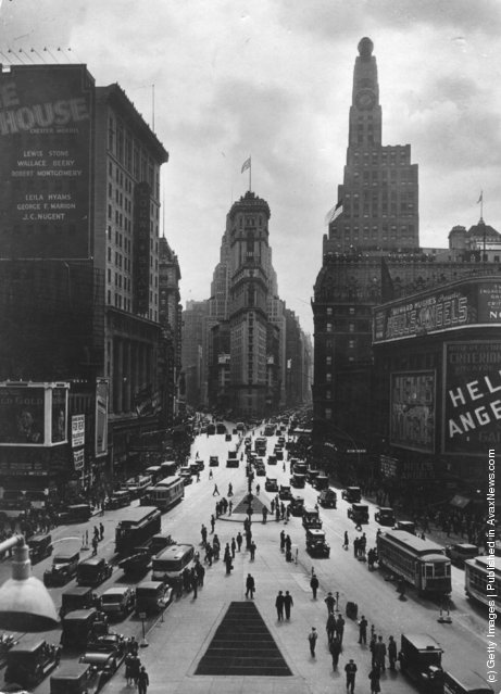 1930: Looking towards the Times Building on Times Square, the Paramount Building is on the right, and Seventh Avenue on the left crossing Broadway