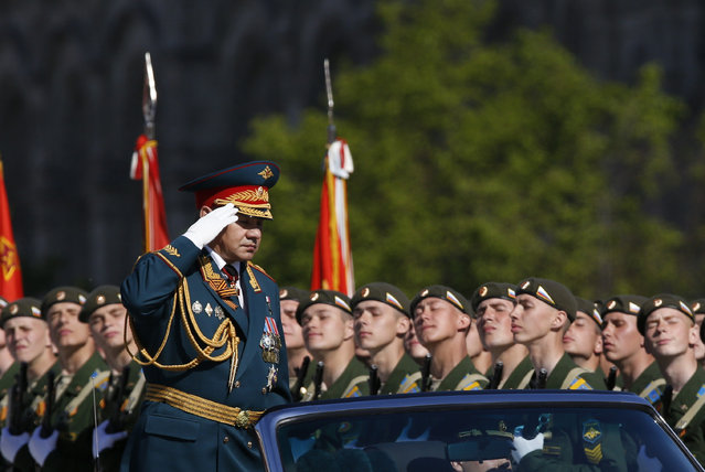Russian Defence Minister Sergei Shoigu (front L) salutes during the Victory Day parade in Moscow's Red Square May 9, 2014. (Photo by Sergei Karpukhin/Reuters)