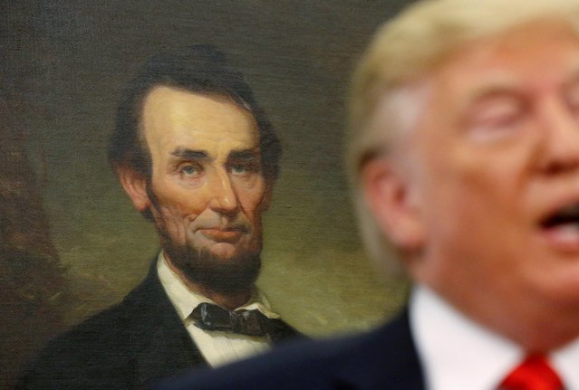 A portrait of late U.S. President Abraham Lincoln hangs in the background as U.S. President Donald Trump speaks during a ceremonial swearing-in for Labor Secretary Eugene Scalia at the White House in Washington, U.S., September 30, 2019. (Photo by Leah Millis/Reuters)