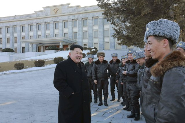 North Korean leader Kim Jong-un (C) smiles during a photo session with fighter pilots at the Workers' Party of Korea (WPK) Central Committee building in this undated photo released by North Korea's Korean Central News Agency (KCNA) in Pyongyang February 2, 2015. (Photo by Reuters/KCNA)