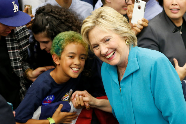 U.S. Democratic presidential candidate Hillary Clinton poses with a supporter after speaking at the University of California Riverside in Riverside, California, U.S. May 24, 2016. (Photo by Lucy Nicholson/Reuters)