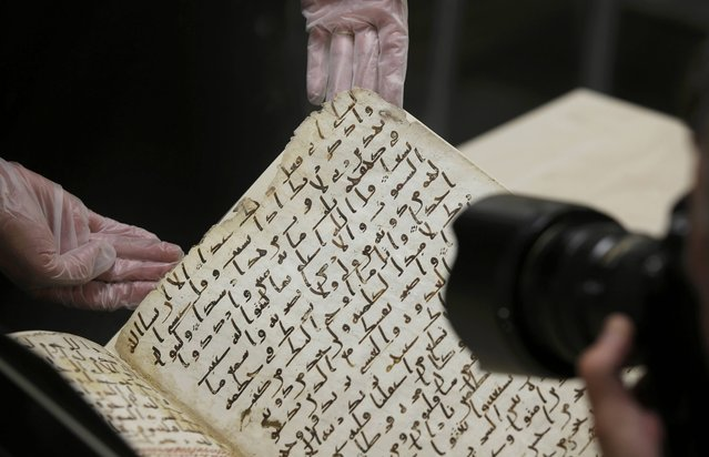 A fragment of a Koran manuscript is photographed in the library at the University of Birmingham in Britain July 22, 2015. (Photo by Peter Nicholls/Reuters)