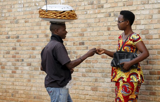 A man sells samoosas at a marketplace in Burundi's capital Bujumbura as the country awaits the results of Tuesday's presidential elections, July 23, 2015. (Photo by Mike Hutchings/Reuters)