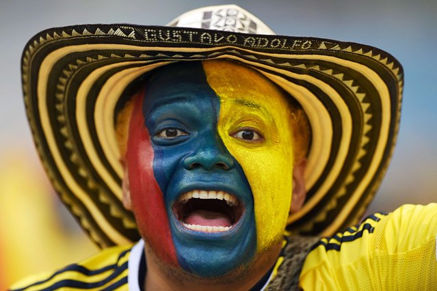 A Colombian supporter waits for the start of a Group C football match between Colombia and Greece at the Mineirao Arena in Belo Horizonte during the 2014 FIFA World Cup on June 14, 2014. (Photo by Eitan Abramovich/AFP Photo)