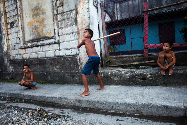 """We still play"". This photo is take in Baracoa, Cuba. Even though is an outdoor scene I believe it gives a sense of Cuba. I only realised fully how amazing Cuba is when I left for Mexico. In Cuba, children still play in the street, it doesn't matter how but they do, even if the don't have a baseball bat! It's a fear free society even though it's changing. People have their doors open, children play outside anytime with anyone and people still trust. It's a beautiful thing going on that reminded me my childhood years in Greece. Photo location: Baracoa, Cuba. (Photo and caption by Stylianos Papardelas/National Geographic Photo Contest)"