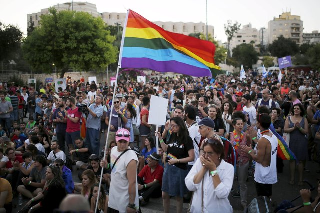 Participants of an annual gay pride parade react after an Orthodox Jewish assailant stabbed and injured six participants in Jerusalem on Thursday, police and witnesses said July 30, 2015. (Photo by Amir Cohen/Reuters)