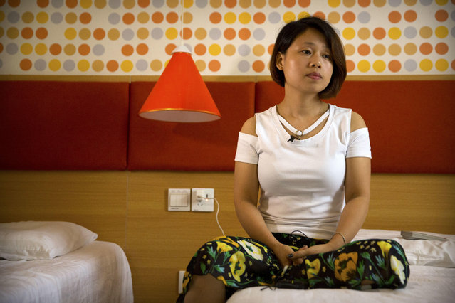 Deng Guilian, the wife of detained Chinese labor activist Hua Haifeng, speaks during an interview in Ganzhou in southeastern China's Jiangxi Province, Tuesday, June 6, 2017. The Chinese government rejected calls to release three activists detained while investigating a Chinese company that produced shoes for Ivanka Trump and other brands and sought to enforce a cone of silence around the men, according to a family member and lawyer who were interrogated and told not to speak to the foreign press. (Photo by Mark Schiefelbein/AP Photo)