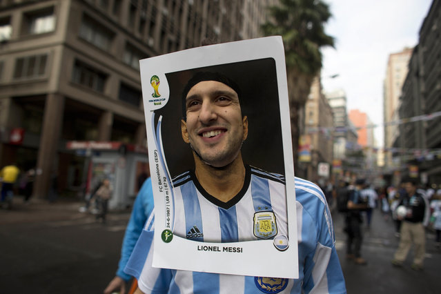 An Argentina soccer fan wears a cutout image of Argentine soccer star Lionel Messi as he heads to the stadium to see the World Cup match between Argentina and Nigeria in Porto Alegre, Brazil, Wednesday, June 25, 2014. (Photo by Dario Lopez-Mills/AP Photo)
