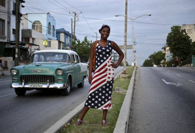 Yavida, 17, poses while wearing a dress with the colors of the U.S. flag on a street in Havana August 4, 2015. (Photo by Enrique De La Osa/Reuters)