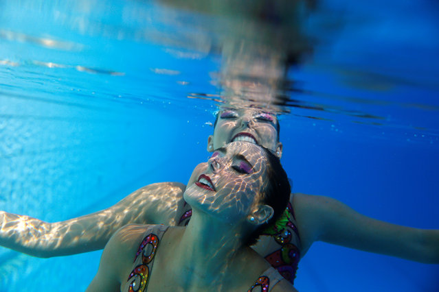 Brazil's synchronised swimmers Luisa Borges (front) and Maria Eduarda Miccuci perform during a training session at the Rio Olympic Park in Rio de Janeiro, Brazil, April 7, 2016. (Photo by Pilar Olivares/Reuters)