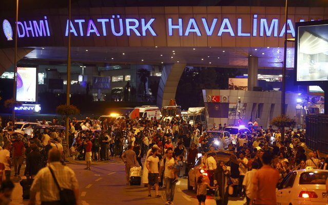 People leave Turkey's largest airport, Istanbul Ataturk, Turkey, following a blast June 28, 2016. (Photo by Osman Orsal/Reuters)