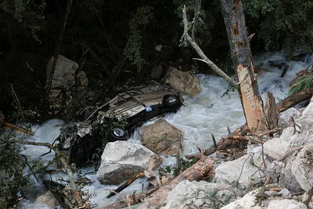 A car lies in a mountain creek beside a road that hit by a rockslide after an earthquake outside Jiuzhaigou, Sichuan province, China, August 10, 2017. (Photo by homas Peter/Reuters)