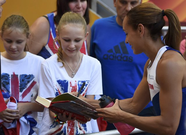 Jessica Ennis-Hill of Britain signs autographs during the high jump event of the women's heptathlon during the 15th IAAF World Championships at the National Stadium in Beijing, China August 22, 2015. (Photo by Dylan Martinez/Reuters)