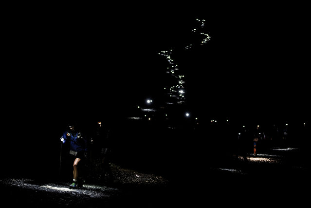 Lights of ultra- trailers competing illuminate the way on September 1, 2017 in Les Contamines Montjoie, during the 15 th edition of the Mount Blanc Ultra Trail (UTMB), a 170 km race around the Mont Blanc crossing France, Italy and Switzerland. (Photo by Jeff Pachoud/AFP Photo)