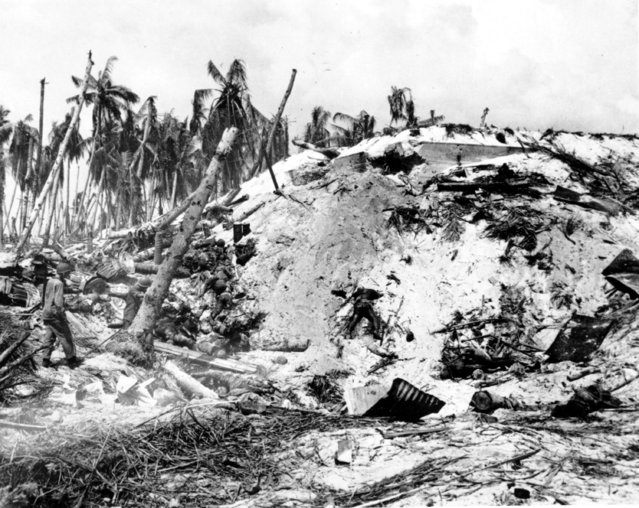 Dead Japanese soldiers lay scattered around a blasted Japanese pillbox at Tarawa Island in the South Pacific on November 11, 1943 during World War II.  A bloody battle ensued after the U.S.Marines invaded the Japanese occupied atoll. This photo by Frank Filan won the Pulitzer Prize in 1944. (Photo by Frank Filan/AP Photo)