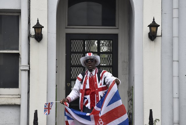 A reveller dances in a doorway at the Notting Hill Carnival in west London, August 31, 2015. (Photo by Toby Melville/Reuters)