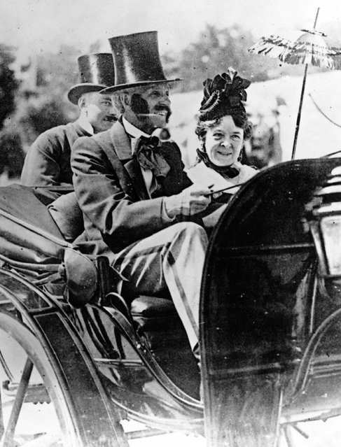 American inventor, industrialist and motor car pioneer Henry Ford (1863–1947) driving an 1860 Pageant motor car whilst his wife Clara sits beside him.