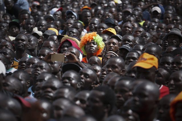 Supporters of Raila Odinga, the leader of The National Super Alliance (NASA) opposition coalition and its presidential candidate, listen to Odinga's speech during his campaign rally in Nairobi, Kenya, 17 September 2017. Odinga once again reiterated that opposition will not take part in presidential election re-run unless the electoral body Independent Electoral and Boundaries Commission (IEBC) is reconstituted by removing some of its officials. The presidential election re-run is set for 17 October 2017. (Photo by Dai Kurokawa/EPA)
