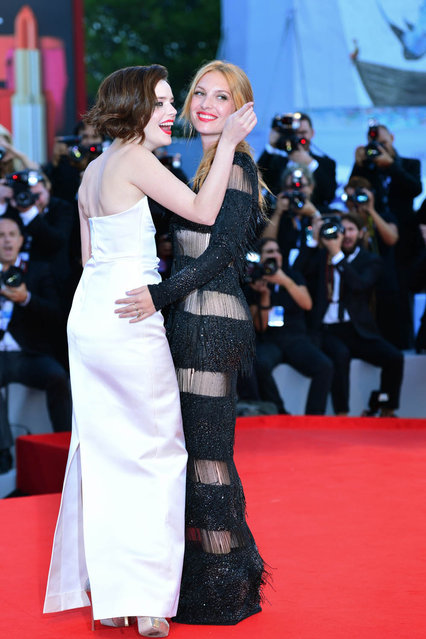 French actress Roxane Mesquida (L) and Josephine De La Baume pose on the red carpet prior the screening of The company you keep during the 69th Venice Film Festival on September 6, 2012 at Venice Lido. The company you keep is presented out of competition.        AFP PHOTO / GABRIEL BOUYS