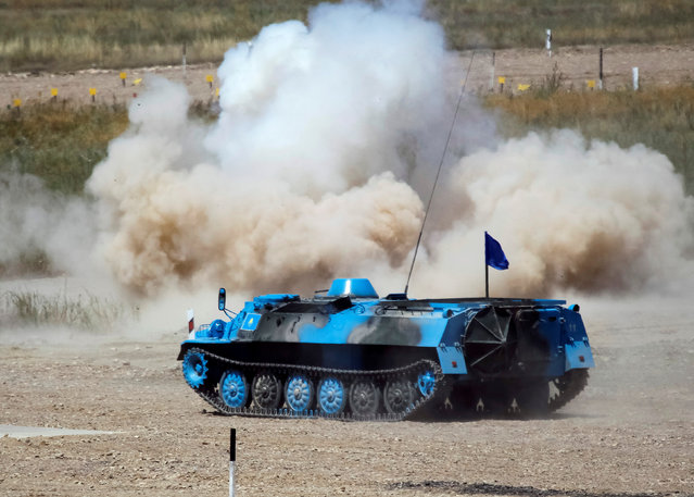 Kazakhstan's army crew rides on a Light Multi-Purpose Armoured Towing Vehicle during mortar units competition at the International Army Games 2016 at Gvardeisky Range, Kazakhstan, August 2, 2016. (Photo by Shamil Zhumatov/Reuters)