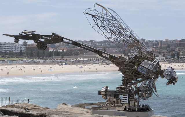 """""""Rangerer"""" by Xia Hang with Bondi Beach in the background at Sculpture By The Sea on October 18, 2017 in Sydney, Australia. """"Influenced by online games, the cyborg-like mosquito has a deeper warning, making real how robotic weaponry might actually work"""". (Photo by James D. Morgan/Getty Images)"""