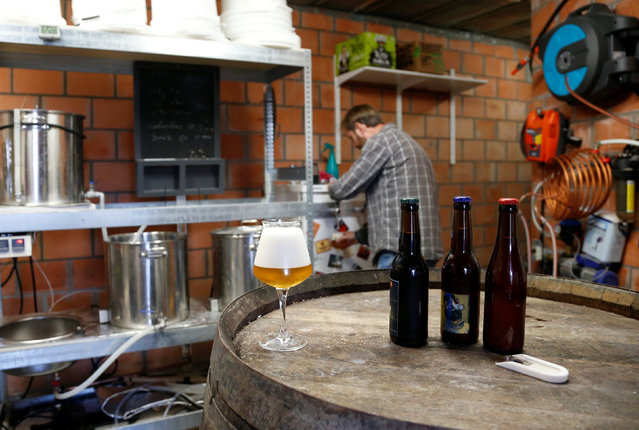 Jeff, member of the Belgian Homebrewers association, pours his own beer in the garage of his house in Sombreffe, Belgium, August 9, 2016. (Photo by Francois Lenoir/Reuters)