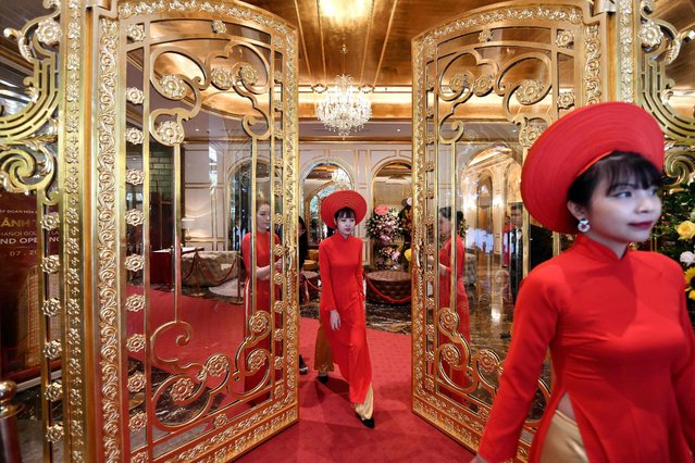 Staff wait to welcome guests in the lobby of the newly-inaugurated Dolce Hanoi Golden Lake hotel, the world's first gold-plated hotel, in Hanoi on July 2, 2020. It even has a gold-plated infinity pool on the roof. The 400-room, 25-storey property will operate under the American Wyndham Hotels brand. Prices start at $300 a night for rooms, or there are apartments to rent costing from $6400 per square metre. (Photo by Manan Vatsyayana/AFP Photo)