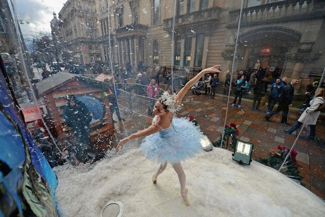 Claire Robertson from Scottish Ballet, poses dressed as the Good Snow Flake inside a life size snow globe on Buchanan Street during a promotion for Scottish Ballet's festive production of The Nutcracker on November 20, 2012 in Glasgow, Scotland. The Nutcracker opens at the Theatre Royal on December the 8th, the production delves deep into the darker reaches of Hoffmann's original tale in a fresh and vivid retelling of the famous Christmas story. (Photo by Jeff J. Mitchell)