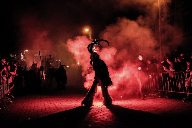 Participants dressed as Krampus walk at the street during Krampus gathering on November 26, 2016 in Zidlochovice (at Brno), Czech Republic. (Photo by Lukas Kabon/Anadolu Agency/Getty Images)
