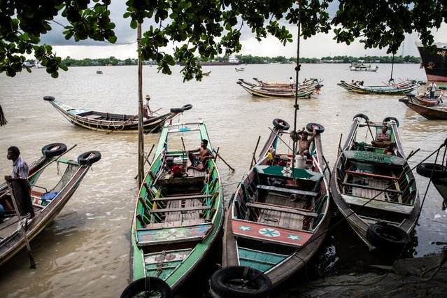 Boatmen wait for their customers at Yangon jetty in Yangon, Myanmar on July 10, 2020. (Photo by Shwe Paw Mya Tin/NurPhoto via Getty Images)