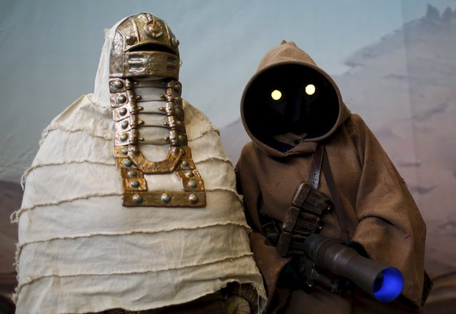 """Some people dressed as Star Wars characters pose at the comic fair """"Vienna Comix"""" in Vienna, Austria, October 3, 2015. """"Vienna Comix"""", one of Europe's largest comic fairs, takes place twice a year and is expected to attract thousands of fans from Austria and the neighbouring countries. (Photo by Leonhard Foeger/Reuters)"""