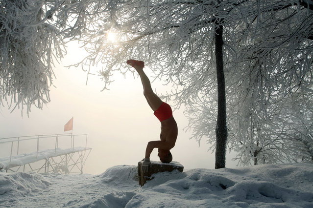 This picture taken on January 17, 2013 shows 77-year-old retired teacher Gao Yinyu exercising in his underwear at a snow-covered bathing spot in Jilin, in northeastern China's Jilin province, in a temperature of minus 25 degrees Celsius. Gao has been exercising in only his underwear every morning for more than the past decade and has rarely caught cold ever since retirement. (Photo by AFP Photo)